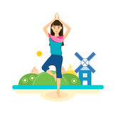 Tropical summer girl is engaged in yoga and meditation. The girl is engaged in the standing position, engage in yoga and meditation, recreation and recuperate Stock Images