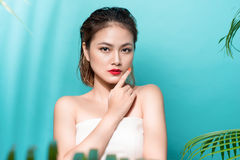 Tropical summer holiday fashion beauty concept. Summer style portrait of young attractive asian woman Stock Photo
