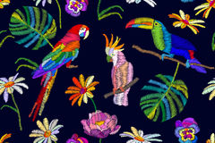 Tropical summer night. Seamless vector pattern with parrots, toucan, flowers and palm leaves on black background. stock illustration