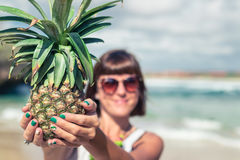 Tropical summer woman with pineapple. Outdoors, ocean, nature. Bali island paradise, Indonesia. Royalty Free Stock Photos