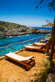 Tropical Sunbeds, Paradise mood. Beautiful beach view with sunbeds and umbrellas at Porto Limnionas beach, Zakynthos, Greece Royalty Free Stock Photo