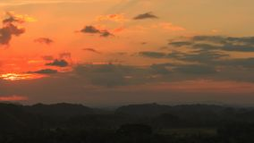 Tropical Sundown 1. Sundown over the Chocolate Hills, Philippines stock video footage