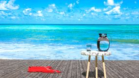 Tropical sunny day haven relaxation, blue green ocean water, wooden pier and blue sky stock photo