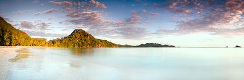 Tropical beach Cote d Or at sunset, Seychelles horizontal background stock image