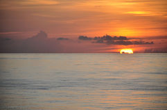 Tropical sunrise over ocean. Intensely colored tropical sunrise over the turquoise ocean Royalty Free Stock Photography