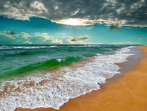 Tropical sunrise over the sea. Tropical sunrise over the turquoise sea during a storm Stock Photo