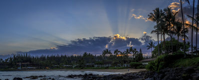 Tropical sunrise. A panorama of Napili Bay on West Maui taken from the south end during a pre-dawn sunrise.  Sunrise over Napili Bay, Maui, Hawaii. sun rays over Royalty Free Stock Photos