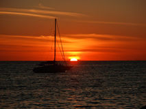 Tropical Sunset. Tropical Ocean Sunset with Sail Boat Royalty Free Stock Image