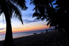 Tropical sunset. A tropical sunset on a beach Stock Photos