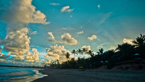 Tropical sunset at the beach. Tropical Sunset on Brazilian beach Royalty Free Stock Photo