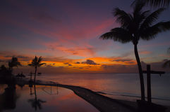 Tropical sunset. On the beach stock photography