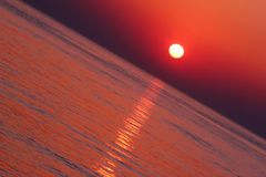 Tropical Sunset. In diagonal composirion stock photo