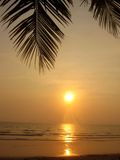 Tropical sunset. Relaxing on tropical beach Stock Images