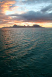 Tropical sunset. On moorea island, with lagoon in foreground Royalty Free Stock Photos