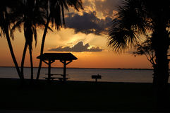 Tropical Sunset. A tropical sunset over a picnic pavilion in Gilchrist Park, Punta Gorda Florida royalty free stock images