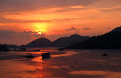 Tropical Sunset in Labuhan Bajo. Sunset over bay in Labuhan Bajo town on the Flores island, Indonesia royalty free stock photo