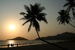 Tropical Sunset. Sunset on the beautiful beach Goa India royalty free stock images
