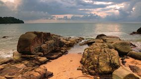Tropical sunset at the beach. Rocks at topical beach at beautiful sunset. Nature background stock footage
