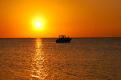 Tropical Sunset and Boat Stock Photos