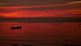 Amazing Colors of tropical sunset with fishing ship. slow motion. Koh Phangan, Thailand. 1920x1080. Tropical sunset with fishing ship stock footage