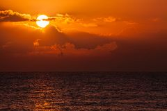 Tropical sunset. Idyllic beach view of sky from vacation island. Royalty Free Stock Photography