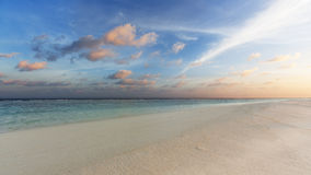 Tropical sunset. Near the island beach at Maldives Royalty Free Stock Image