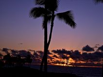 Tropical Sunset. Nothing like the tropical sunset to set the tone of restful tranquil vacation Stock Images