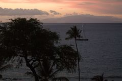Tropical Sunset over beach in Maui Hawaii Royalty Free Stock Photography