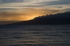 Tropical Sunset over beach in Maui Hawaii Royalty Free Stock Photo