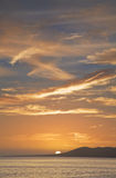 Tropical sunset over ocean Stock Images