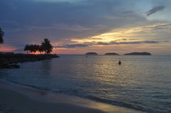 Tropical sunset over ocean and island Kota Kinabalu Stock Photo