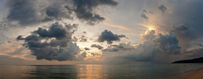 Tropical sunset. Panorama. Sunset in tropical bay. Dramatic sky with sunbeams. Panoramic picture Royalty Free Stock Image