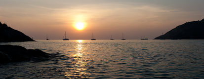Tropical sunset. Panorama. Sunset in tropical bay. Sailboats silhouette. Phuket, Thailand Stock Image