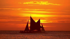 Tropical sunset. Sail boats silhouettes on ocean horizon. Boracay, Philippines stock video footage