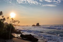 Tropical sunset and scenic beach. Scenic landscape of tropical sunrise and beautiful beach and ocean in Sri Lanka Stock Image