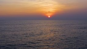 Slow motion aerial shot Tropical sunset. the sea waves in the evening light, beautiful sky gradient. Tropical sunset. the sea waves in the evening light stock video footage