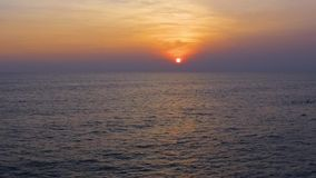 Tropical sunset. the sea waves in the evening light, beautiful sky gradient. Tropical sunset. The sun sets over the ocean, the sea waves in the evening light stock footage
