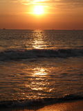 Tropical Sunset & seascape. An orange sunset reflecting golden light on to the sea Stock Images