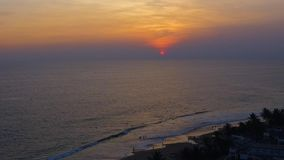 Tropical sunset. The sun sets over the ocean in tropical country, the sea waves in the evening light. Tropical sunset. The sun sets over the ocean, the sea waves stock footage