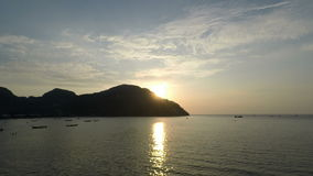 Tropical sunset in thailand. Sunset over lo dalum bay on ko phi phi island in thailand stock footage