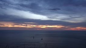 Tropical Sunset Time Lapse Scene in the Sea. Phuket Lam Phromthep. Sun and Cloud stock video footage