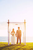 Tropical Sunset Wedding Stock Images