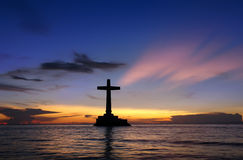 Tropical Sunset With Cross Silhouette. Royalty Free Stock Photos