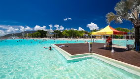 Tropical swimming lagoon on the Esplanade in Cairns with artificial beach, Queensland, Australi. CAIRNS, AUSTRALIA - 27 MARCH 2016. Tropical swimming lagoon on stock footage