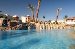 Tropical swimming pool. Close up of blue water in luxurious tropical resort swimming pool Stock Photos