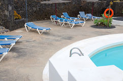 Tropical swimming pool area Royalty Free Stock Photo