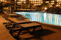 Tropical swimming pool by night Stock Photo