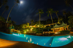 Tropical swimming pool. In night view Stock Photo