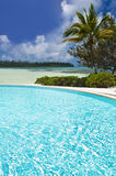 Tropical swimming pool by the sea Royalty Free Stock Photos