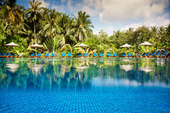 Tropical swimming pool. Views over the water and under water. Maldives Royalty Free Stock Photo